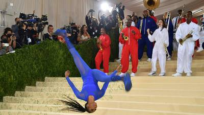 Photos: Gymnast Nia Dennis, marching band steal the show at Met Gala 2021