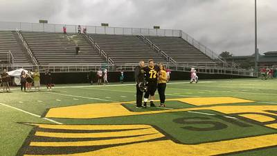Sidney officer shot in the line of duty surprises son at high school senior night