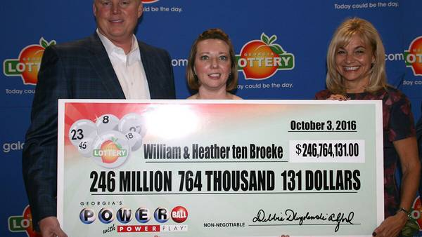 Couple claims $246M Powerball jackpot after woman reminds husband to buy ticket